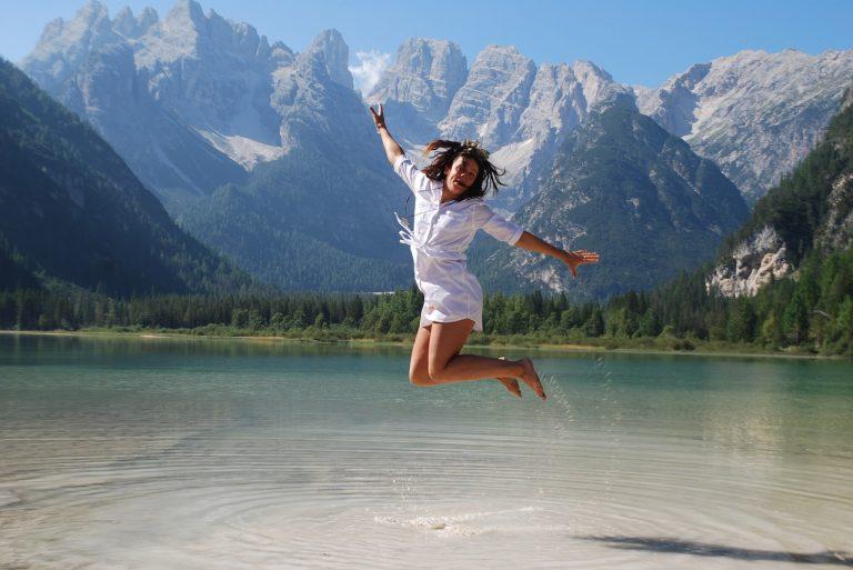 girl jumping for joy, girl happy, happy